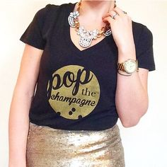 POP the Champagne Bubbly Graphic Tee ❌NO TRADES❌  - V-Neck Short Sleeve black Tee (60% cotton, 40% modal) w/ gold vinyl.  - $28 Plus Sizes  - See final photo for fit details. Tags cut for proprietary supplier info.  - Tees are handprinted by yours truly. Made to order. Item may be slightly dif from the photos. EX: where and how much ink is distributed, etc..  - DO NOT PURCHASE THIS LISTING. Comment SZ and I'll create a CUSTOM listing Tops Tees - Short Sleeve
