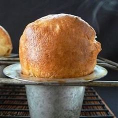 The secret to light and airy popovers is a very light touch in mixing and a very hot oven for baking.  These are best served hot from the oven.