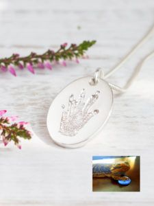 stunning! real bearded dragon pawprint on a silver necklace pendant . . . #beardeddragon #dragon #pawprint #dragonpaw #pawprintjewelry #custommade