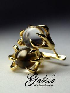 Золотые серьги с горным хрусталем Когти
