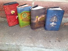 Hand tooled leather LOTR and Hobbit covers (The door on the hobbit hole opens!) <3 Oh wow I have a mighty need
