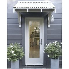 """From the always great """"Steal this Look"""" section on Remodelista, Sarah offers a recipe to create a Farmhouse Modern entry (or side door). This is very strange because it is almost exactly the entry we created (I will post it when the metal roof is on. House Colors, Modern Entry, Modern Farmhouse, Back Doors, Door Awnings, Door Overhang, Doors, House Exterior, Barn Lighting"""
