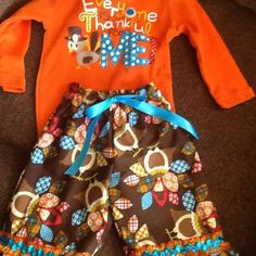 3-6  mos onesie, decorated with ribbon and buttons, and handmade pants