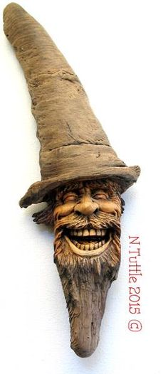 """""""Medicinal Laughter"""" 16 inches tall and 5 inches across the brim of his hat. Signed and dated: N. Tuttle 9/19/15 Wood Carving Faces, Wood Carvings, Dremel Carving, Tree People, Wooden Walking Sticks, Driftwood Art, Whittling, Wood Sculpture, Artist At Work"""