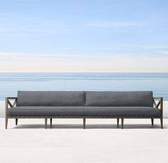 """RH's 121"""" Mustique Aluminum Sofa:Designed in Australia by a family-owned company known for its meticulous metalwork, our collection pairs classical elements with the low-profile cubes of midcentury modernism. Masterfully handcrafted of rustproof aluminum and mesh strapping detailed with metal studs, it's a choice for the ages."""