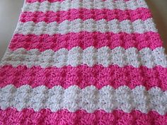 This is an easy baby afghan that is crocheted with a J hook. You can crochet it quickly with worsted weight yarn. I used 2 colors - pink and white. You will need 7 oz of each yarn.