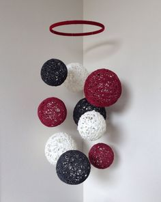 Baby mobile with red, black and white yarn balls on Etsy, $50.00