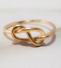 More a sculptural piece than a simple ring, this knot ring is formed by hand from thick 14K gold wire.