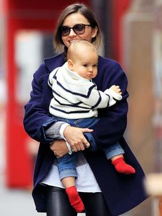 FLYNN BLOOM  Bright socks, check! Striped sweater, check! Cool jeans, check! Orlando Bloom's cherub-cheeked baby boy, who turns 1 a week before dad's Jan. 13 birthday, stays stylishly in step with model mom Miranda Kerr while the duo run errands in N.Y.C. on Nov. 13.