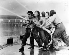 "Pearl Harbor:""A crew of women fire fighters, all crews having been chosen from personnel working in the immediate vicinity of the pumper stations. From left to right: Elizabeth Moku, Alice Cho, KATHERINE LOWE and Hilda Van Gieson."""