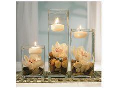 Arreglo de flores con orquídeas y velas / centro de mesa con velas