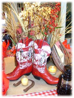 Cowboy boots used on table to hold florals for a western party or bbq