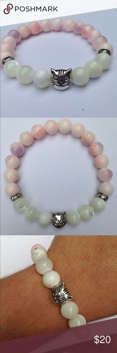 "White Mother of Pearl Pink Quartzite Cat Bracelet This lovely bracelet features light, pastel colors with great luster. Made with natural mother of pearl and dyed pink quartzite, this piece is an eye catcher. The kitty cat centerpiece is silver tone. This is on elastic and will stretch to fit up to an 8"" wrist. All PeaceFrog jewelry items are made by me! Take a look through my boutique for more unique creations. PeaceFrog Jewelry Bracelets"
