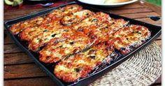 Aubergines à la Parmigiana (pour 4 personnes) 3 aubergines 1 boite de tomates concassées – ou tomates fraiches pelées et concassées en saison 1 cc de concentré de tomates 1 oignon 2 gousses d'ail Origan séché Basilic frais 1 feuille de laurier fraiche 2 piments oiseau Sel, poivre ¼ de verre de vin blanc sec 3 boules de mozzarella Parmesan Huile d'olive