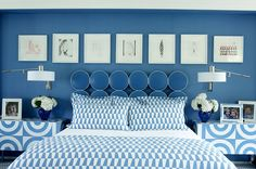 Blue and White... fresh and uplifting. Love the movable wall sconces and the usage of pattern on pattern, but all white based.