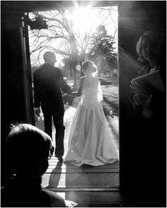 from behind as they start to walk down the aisle or as they go out on the dance floor.