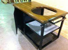 Mahogany and steel Big Green Egg table.