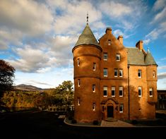 From the moment you first glimpse Fonab Castle Hotel from its curving, tree-lined driveway, it's clear this isn't your traditional castle stay. A four-storey pile of red sandstone, boasting a jumble of conical turrets, chimneys and crow-stepped gables, it soars beside a sprinkling of chic wooden lodges that could have been plucked out of Lapland or the Canadian Rockies.