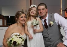 One of my sweet brides!  Groom & Flower girl too!  bouquets by www.CreationsbyDebbie.net