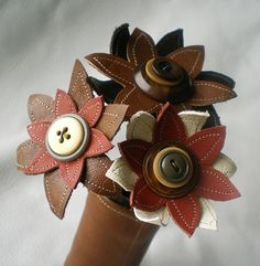 made from reclaimed leather and vintage buttons  very cool!
