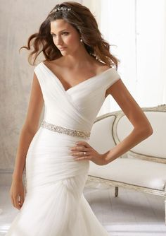 Wedding Gowns By Blu featuring 5210 Asymmetrically Draped Soft Net -Shown with Crystal Beaded Organza Tie Sash Sash also sold separately as Style 11054. Colors Available: White, Ivory. Sizes Available: 2-28.