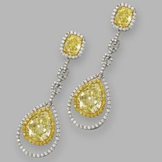 Pair of fancy colored diamond and near colorless diamond pendant-earrings | Lot | Sotheby's