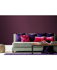 Purple hues with a grey sofa to anchor
