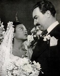 Scott and Powell on their wedding day