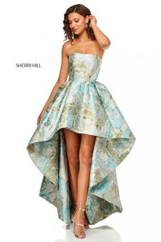 b94fa2e1895 Style 52143 from Sherri Hill is a high low strapless prom gown in a muted  floral. French Novelty