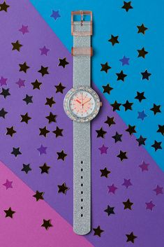 It's raining glitter on GLITTERAXUS (ZFCSP083), where the silver bezel, case, and strap glisten in the light for a non-stop planetary party. One of our most fun watches for kids, its creative design makes it an ideal gift to help learn the time while they explore space. This stylish wrist watch for kids is also grounded with practical details, like shock and water resistance and BPA-free components. Cool Watches, Creative Design, Swatch, Glitter, Explore, Stylish, Party, Silver, Fun