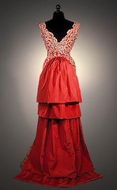 "Cristobal Balenciaga 1959 ""Eisa"" Dress of red taffeta with slim silhouette and satin bustle."