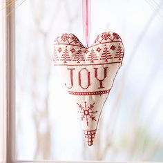 Joy Cross-Stitch Heart Ornament  Show your enthusiasm for winter by stitching your feelings on this heart-shape ornament.