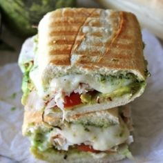 turkey pesto avocado panini  •1 TBSP olive oil  •1 loaf of French bread, cut into 3-4 equal pieces  •1/2 cup pesto, homemade or store-bought  •4-8 ounces mozzarella, sliced  •2 cups chopped turkey  •2 Roma tomatoes, sliced  •1 avocado, sliced