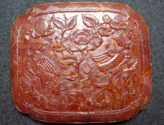 Amber plaque with Phoenix and flowers. Ming dynasty, China. Private collection