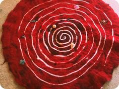red tent spiral...throwing it in to stay open to non-moon imagery...that still seems to reference the moon with its shape