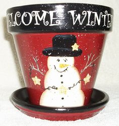 Hand Painted Whimsical Terra Cotta Flower Pot With Snow Man and Welcome Message. $24.99, via Etsy.
