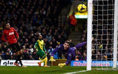 Credit: Michael Regan/Getty Images David De Gea dives and keeps his eye on the ball as Nathan Redmond's shot flies just wide of his left-han...