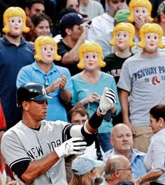 Fans at Fenway Park in Boston wear blonde masks as New York Yankees third baseman Alex Rodriguez goes to bat in the first inning of their baseball game against the Boston Red Sox at Fenway Park in Boston on June 1, 2007. (Winslow Townson/AP)