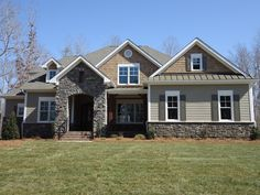 Stone for porch fireplace = Country Rubble Grey Quartzite Metal Siding, Vinyl Siding, Metal Roof, Cottage Exterior, Exterior House Colors, Stained Front Door, Arthur Rutenberg Homes, Craftsman Ranch, Siding Options