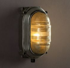 French nautical sconce. Would be awesome in the bathroom that goes with Old World steamer travel bedroom in my imaginary mansion.