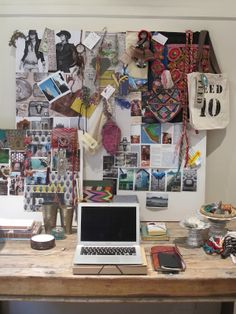 Textiles, fashion photos and magazine clippings. Accessories designer? Nice desk! (Inspiration board/mood board/picture wall, artist studio/office.)