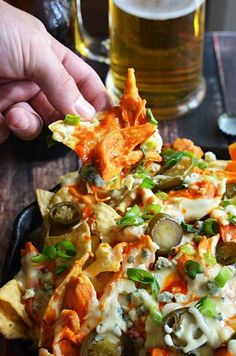 Could this be any more perfect for football season? Shredded buffalo chicken, cheesy ranch queso, blue cheese crumbles, pickled jalapenos, and chopped green onions! T (Buffalo Chicken Marinade) Buffalo Chicken Nachos, Shredded Buffalo Chicken, Buffalo Chicken Dip Recipe, Chicken Nachos Recipe, Chicken Recipes, Beef Nachos, Nachos Loaded, Gourmet Chicken, Chicken Kitchen