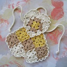 Used the heart motif from this square (excellently written and charted) for the bodices, except in edging I skipped both chains of at point of heart, then continued on with chains and sc ever. Crochet Mask, Crochet Towel, Crochet Potholders, Crochet Doilies, Crochet Flowers, Crochet Hot Pads, Knitting Dolls Clothes, Crochet Flower Tutorial, Crochet Kitchen