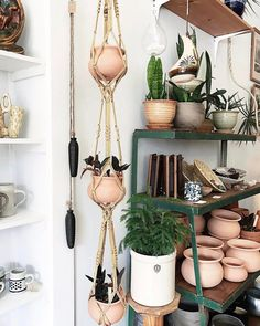 Okay this triple tier macrame hanger over at our pop-up shop is just too much! Just magical the synergy between plants and vintage goods. Way jealous of whoever swooped this one up! Link to all the pottery in our bio Market Displays, Store Displays, Macrame Projects, Macrame Art, Macrame Plant Hangers, Visual Display, Garden Shop, Textiles, Plant Holders