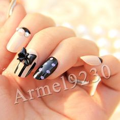 Variety nails: stripes, polka dots, rhinestones, pearls, and a 3D bow