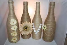 Set of 4 decorated wine bottles: wrapped in twine, spells LOVE