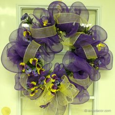 "Purple pansies adorn this purple mesh wreath. A touch of 2.5"" yellow mesh ribbon, yellow bumblebees, and purple butterflies complete the look. (30 in) Only $70.00"