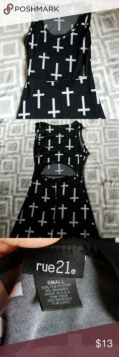 Dress Black dress with white crosses on it. From rue21. EUC has a small opening on the back of the dress to show off a little skin. Very comfortable and silky. Rue 21 Dresses