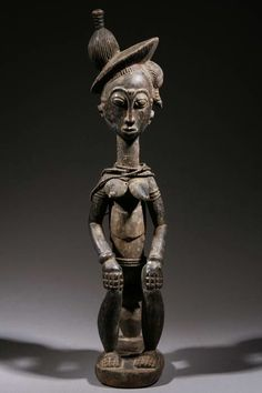 Africa | Carved wooden statue from the Baoulé people of the Ivory Coast | ca. 30 yrs old