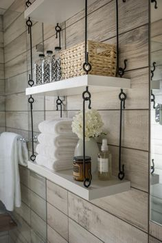 """Clever hanging storage maximizes space in the universal design bathroom. """"We had a situation where the floor and all of the walls are tiled and no place to put anything you need to have in a bathroom, so we came up with this shelving idea that David Brown built for us that is modern looking, clean, simple and it really feels perfect in this room,"""" says interior designer Linda Woodrum."""